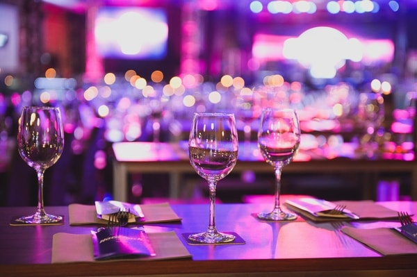 venue lighting uplit purple table setting